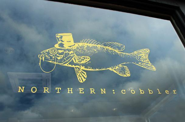 Northern Cobbler logo on the window of their shop on the corner of Clarendon Park Road and Queens Road in Leicester