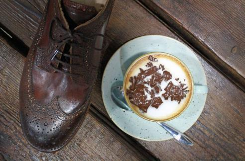 A gent's brogue and a cappuccino, both for sale in Northern Cobbler, Leicester