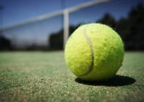 Close up of tennis ball on tennis court