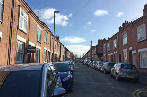 Hartopp Road today with cars parked down each side and electric street lamps
